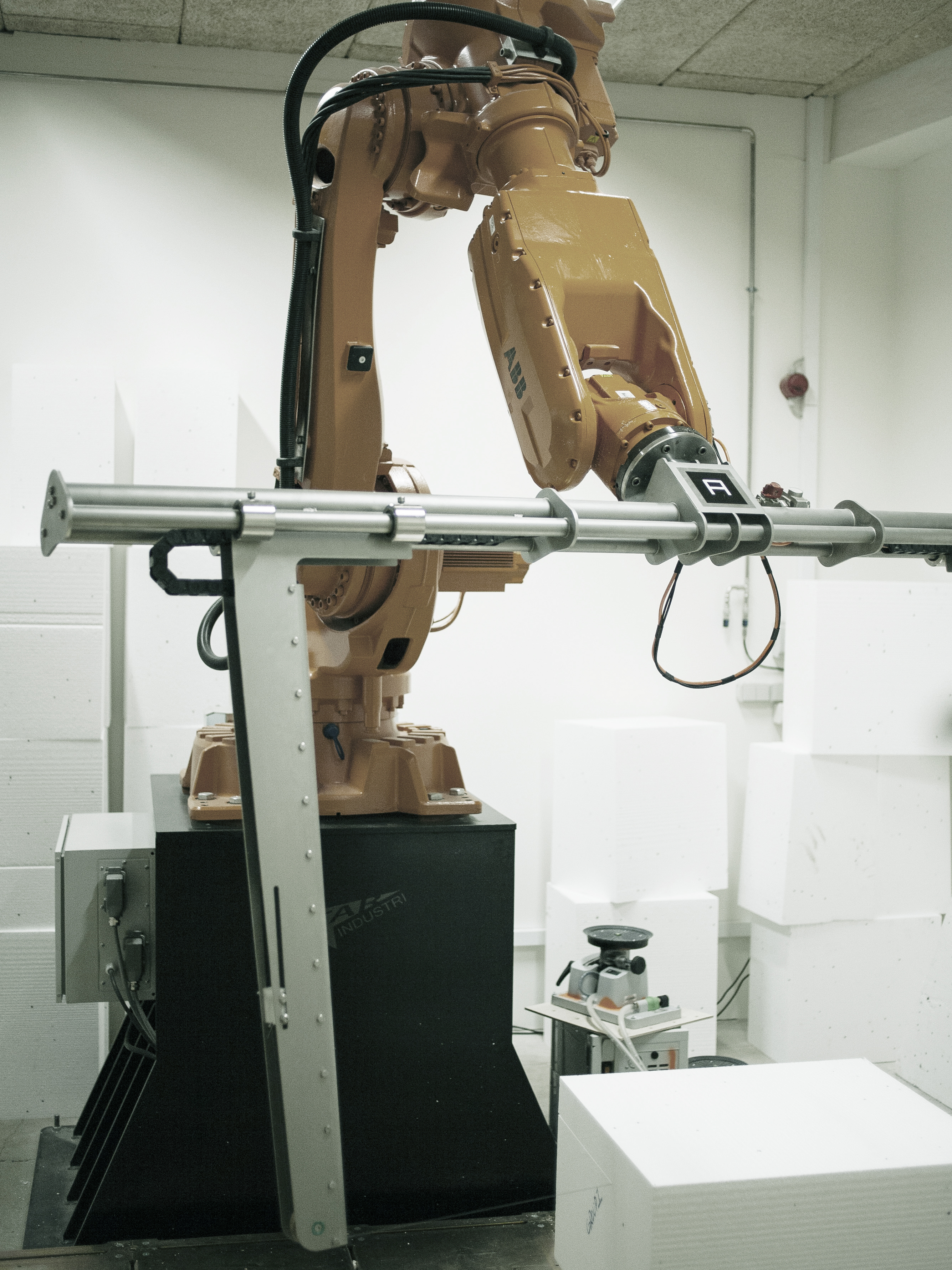 FOAM TO WOOD VENEER VIA ABB IRB 6620 ROBOT